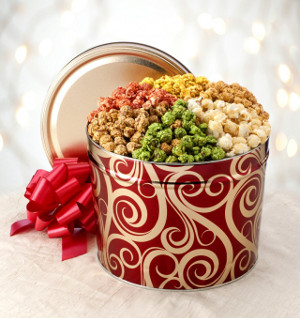 Colorful tin filled with six tropical flavors of fluffy coated popcorn