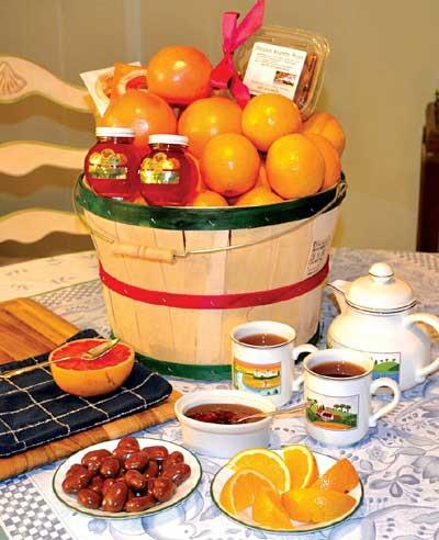 Tea time basket of gourmet florida citrus, orange blossom honey, chocolate amaretto pecans and rooibos tea.