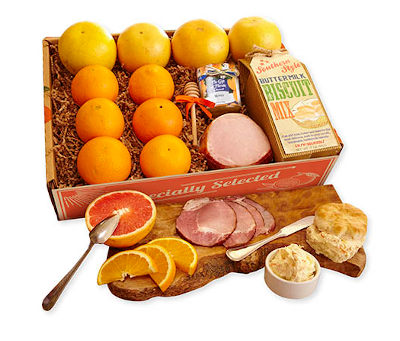 Brunch combo of oranges, grapefruit, bicuit mix, honey and bacon.
