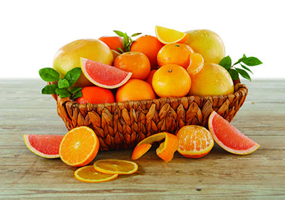 Rustic woven basket with grapefruit, oranges and tangerines.