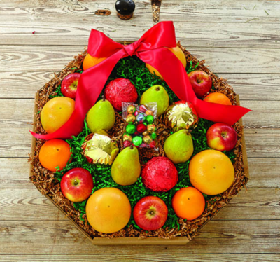 A wreath style box filled with Oranges, Grapefruit, apples and pears.