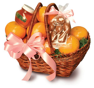 Two handled woven wicker basket filled with sweet Honey Tangerines.