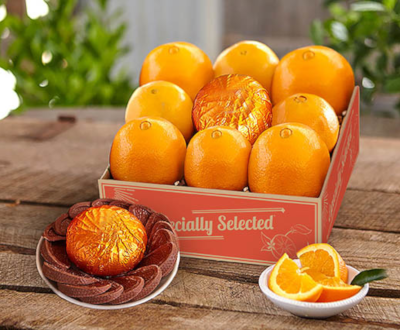 Sweet Navel Oranges surrounding a citrus infused chocolate orange.