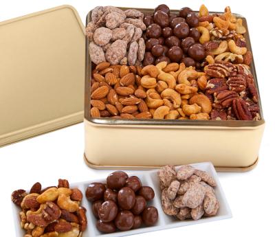 Six varieties of Premium Jumbo Nuts in a Golden tin. No peanuts.